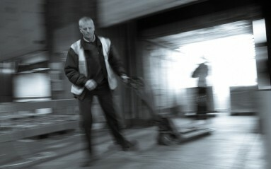 Commercial Photography Example - Warehouse motion shot of man pulling forklift