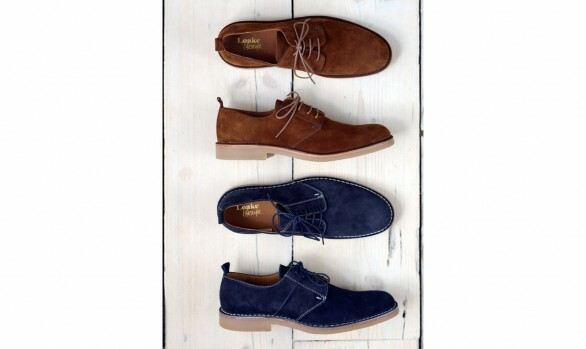 Photograph of two pairs of Loake shoes in brown and blue suede on a wooden background