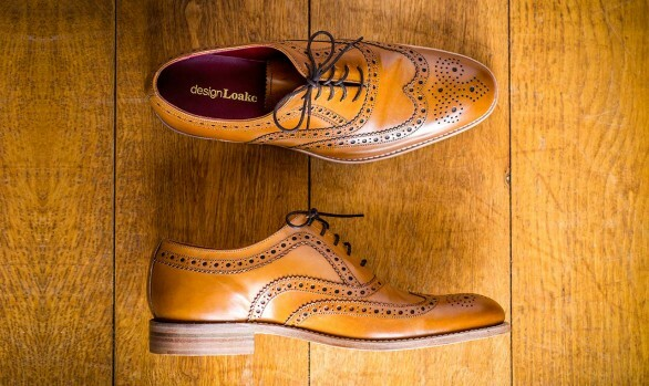 Mens Brown brogues photographed on wooden background